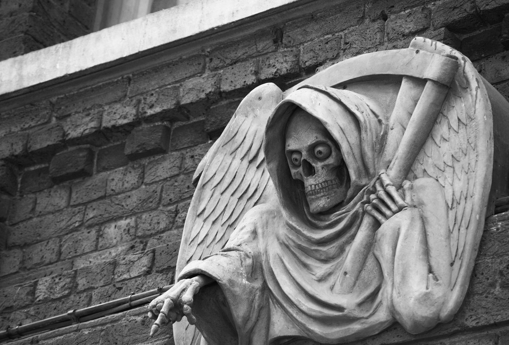 statue outside the London Dungeon, UK