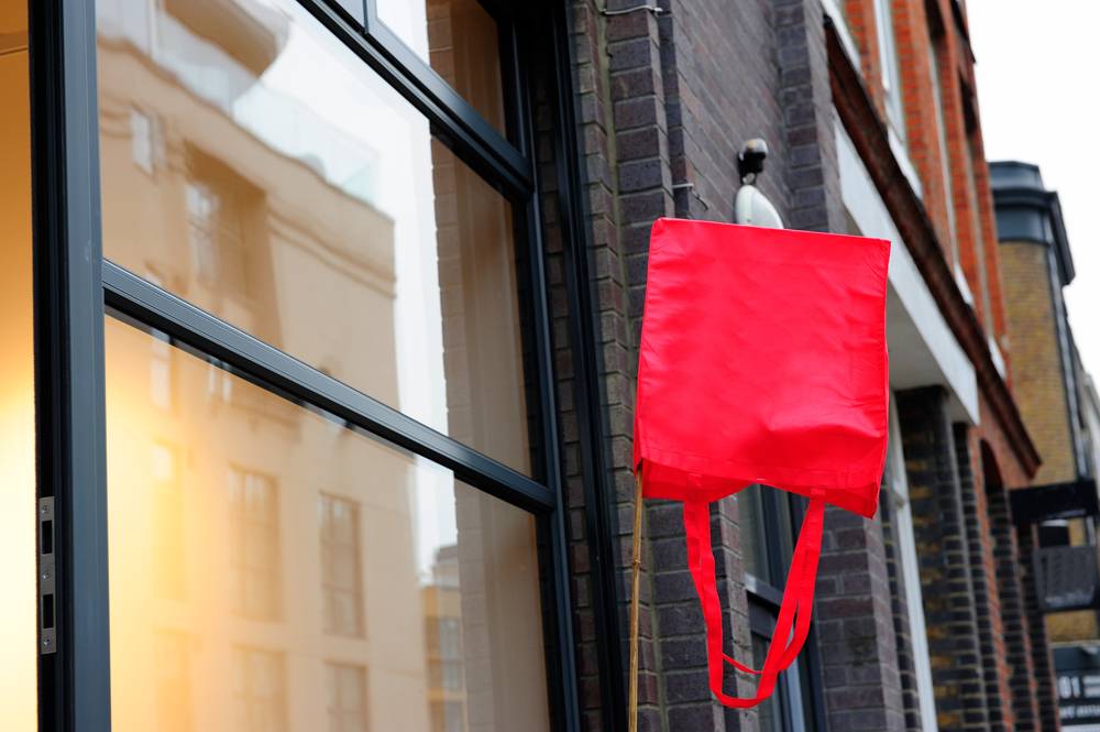 Red bag hanging in front of the shop in Shoreditch, London, England
